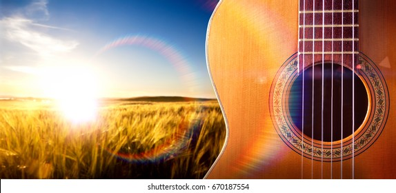 Spanish guitar and music background.Spanish culture. Musical design with acoustic guitar and sunset landscape