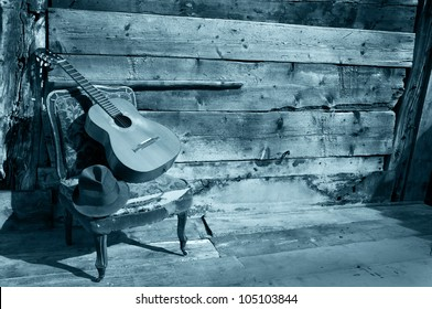 spanish guitar on a old chair with wooden background horizontal blue