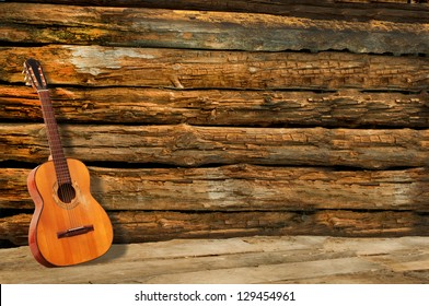 spanish guitar with wooden background