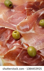 Spanish ham with green olives