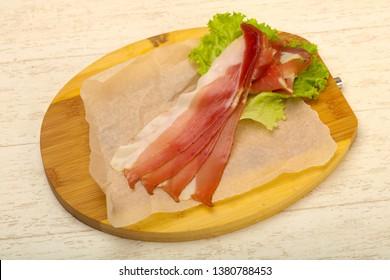 Spanish Hamon over wooden background