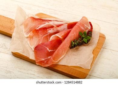 Spanish hamon ready for eat ovet the wooden background