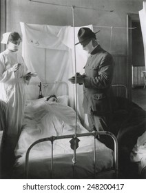 Spanish Influenza in American Army hospitals. Masks and cubicles were used at Fort Porter, where patients' beds are reversed, so breath of one will not be directed toward another. Nov. 19, 1918.