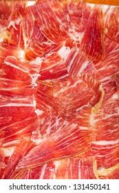 Spanish jamon iberico sliced, background