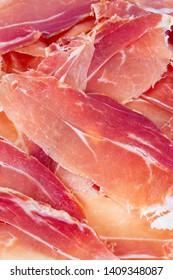 spanish jamon serrano isolated on white