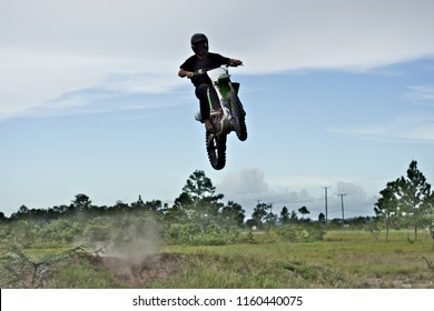 Spanish lookout, Belize - AUGUST 19, 2018 Kenneth Braun taking his Kx250f into the air.