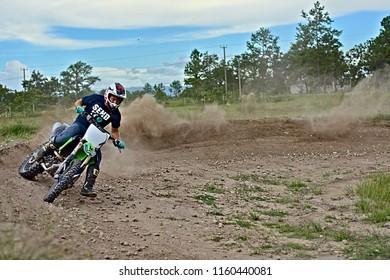 Spanish lookout, Belize - AUGUST 19, 2018 John Wayne Friesen drifting a Kx250f around a speed curve at Arrow Raceway