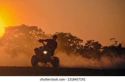 Spanish lookout, Belize - February 17, 2019  Eric drifting around a corner against the sunset with a 2013 LTZ400