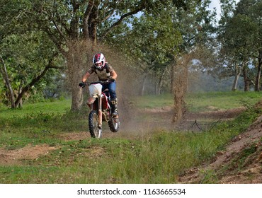 Spanish lookout, Belize February 18, 2018 John Wayne Friesen splashing through a water puddle with his CRF250R on a trail through the woods