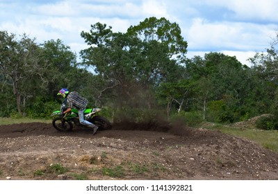 Spanish lookout, Belize - January 27, 2018 Christopher Plett riding his bike on the muddy track
