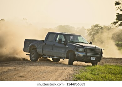 Spanish lookout, Belize - JULY 20, 2018 Ely Penner drifting his dad's truck around a corner on one of the back roads in Spanish lookout