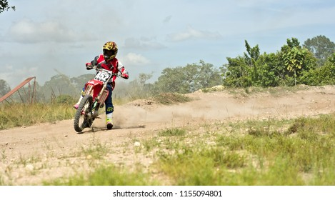 Spanish Lookout, Belize - JULY 29, 2018 Timothy Friesen Drifting his CRF250R around a speed curve on the arrow raceway