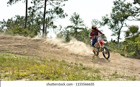 Spanish lookout, Belize - JULY 29, 2018 Timothy Friesen drifting his CRF250r on Arrow Raceway.