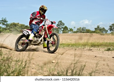 Spanish lookout, Belize - JULY 29 2018  Timothy Friesen drifting his CRF250r around a speed curve on the Arrow race way