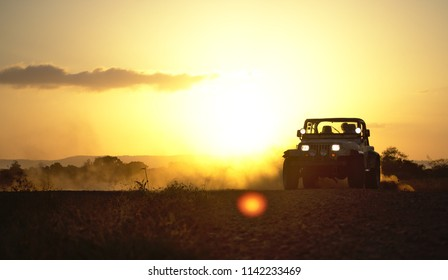 Spanish lookout, Belize - MARCH 26, 2018 Ely Penner drifting his dad's Jeep Wrangler under a beautiful Belizean sunset