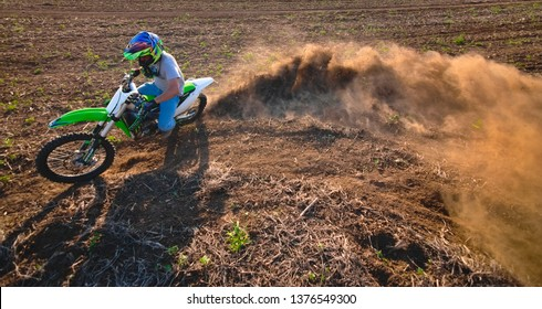 Spanish Lookout, Belize - March 31, 2019 Christopher Plett Drifting on a field with his Kawasaki KX450F