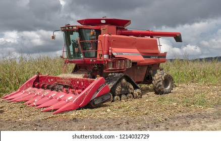 Spanish Lookout, Belize - October 2, 2018: Farmer parks his Case IH combine on the field.
