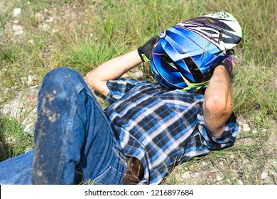 Spanish lookout, Belize October 30, 2018 Christopher Plett laying on the ground after having an accident on the motocross track at Arrow Raceway.