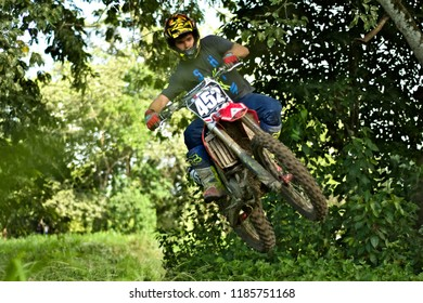 Spanish lookout, Belize - September 2, 2018 Timothy Friesen riding a trail with his honda crf250r at Mennonite beach