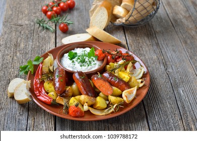 Spanish meal: Baked hot chorizo sausages with rosemary vegetables and mediterranean herb curd