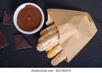 Spanish and mexican dessert : homemade churros  with chocolate
