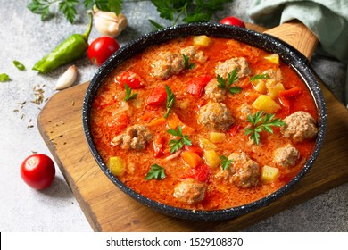 Spanish and Mexican food - Albondigas. Hot stew tomato soup with meatballs and vegetables.