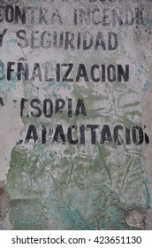 Spanish old wall with typography : in fire... and safety... signaling... training (encontra incendio ... y seguridad... señalización... capacitacion)