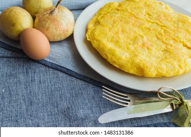 spanish omelette called tortilla de patatas with vintage cutlery