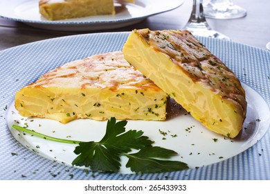 Spanish omelette with potatoes and onion, typical Spanish cuisine / Tortilla espanola