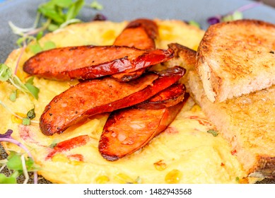 Spanish Omelette topped with slices of grilled chorizo