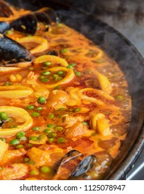 Spanish paella is being cooked in a large pan at a street market in Melbourne Australia