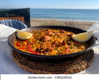 Spanish paella on a beach in spain, foto taken in marbella, malaga. Delicious spanish food.