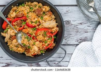 Spanish paella with prawns, chicken, chorizo and red pepper - top view
