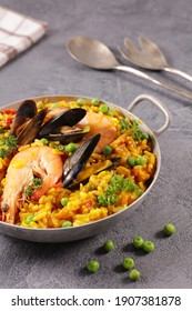 spanish paella with seafood and pea