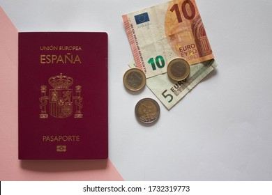 Spanish passport with euro bills and coins for a local trip around Spain. Madrid/Spain: May 15 2020