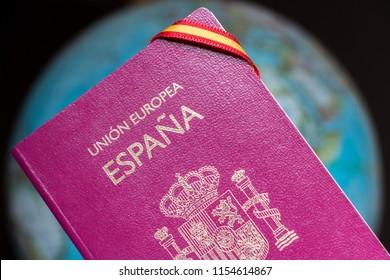 Spanish passport, spanish flag and earth globe
