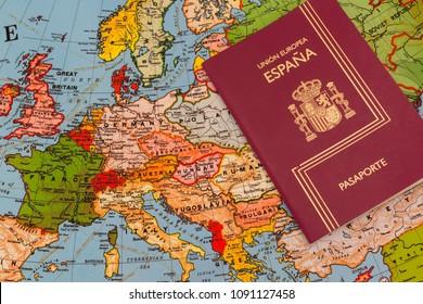 Spanish passport over a Europe map