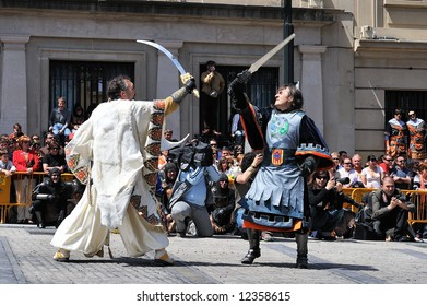 spanish people in fiesta - moors and christians - street fight