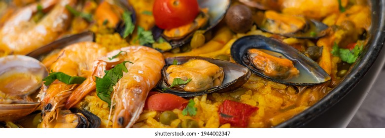 Spanish seafood Paella de Marisco, Paella Marinera with mussels, shellfish and scampis, panorama view