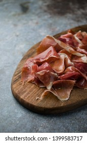 Spanish Serrano ham on cutting board
