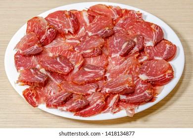 a lot of Spanish serrano ham and Spanish sausage, fuet, Iberian pork loin