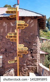 Spanish sign post on Isla Amantani on Lake Titicaca, showing distance to various cities