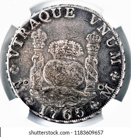 Spanish silver dollar dated 1765 sometime called Piece of Eight. Used by pirates as silver money.