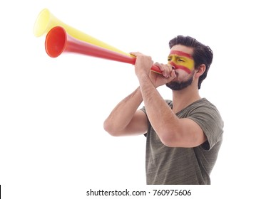 Spanish soccer fan blowing a vuvuzela