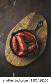 Spanish spicy chorizo sausages cooked in frying pan