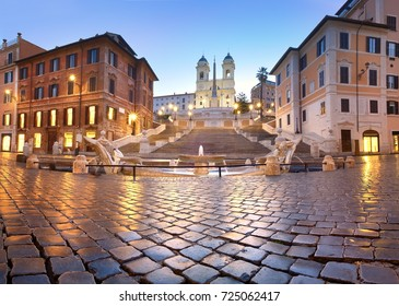 Spanish Steps and a boat-shaped fountain on Piazza di Spagna in Rome, Italy. Early morning panoramic shot after rain.