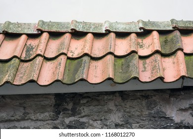 Spanish style ceramic tile roof with blue sky. Background texture - Mediterranean architectural details.