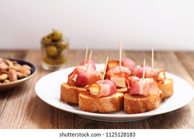 Spanish tapa made of bacon, cheese and white bread