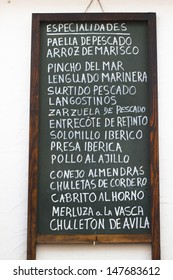 Spanish tapas advertised on a blackboard in Granada