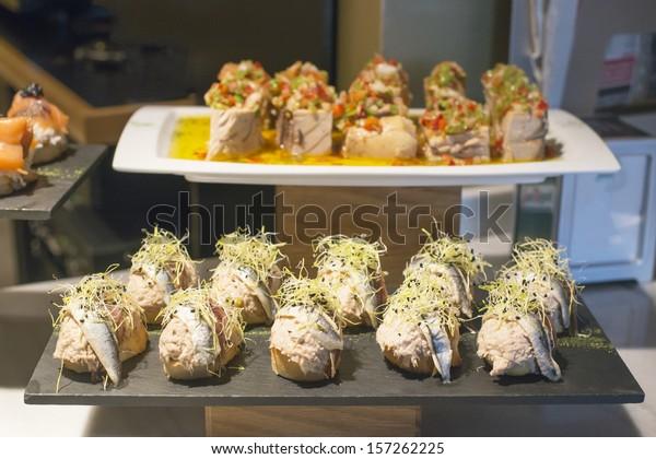 Spanish tapas of anchovies, salad and tuna.